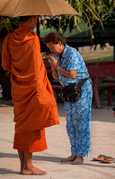 Woman Praying with Monk (Cambodia)