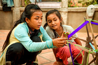 Girls Weaving Silk (Cambodia)